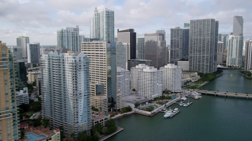 5K stock footage aerial video flyby waterfront skyscrapers to reveal Brickell Key Bridge in Downtown Miami, Florida Aerial Stock Footage | AX0021_120
