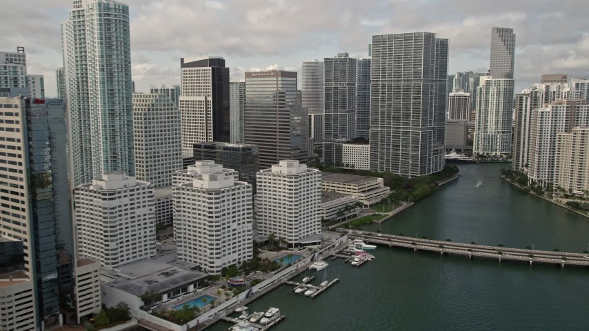 5K stock footage aerial video flyby waterfront skyscrapers to reveal Brickell Key Bridge in Downtown Miami, Florida Aerial Stock Footage | AX0021_120E