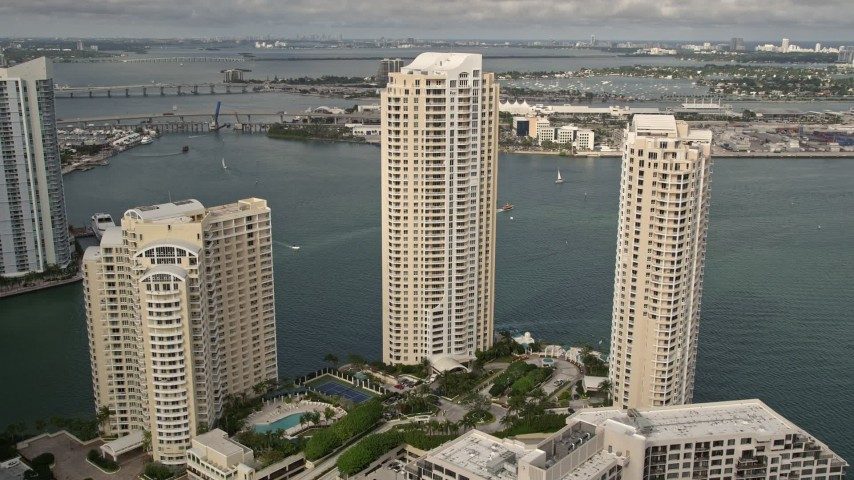 5K stock footage aerial video of waterfront skyscrapers on the shore of Brickell Key, Downtown Miami, Florida Aerial Stock Footage | AX0021_122