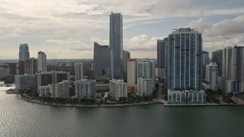 5K stock footage aerial video of bayfront skyscrapers on the shore of Downtown Miami, Florida Aerial Stock Footage | AX0021_123E