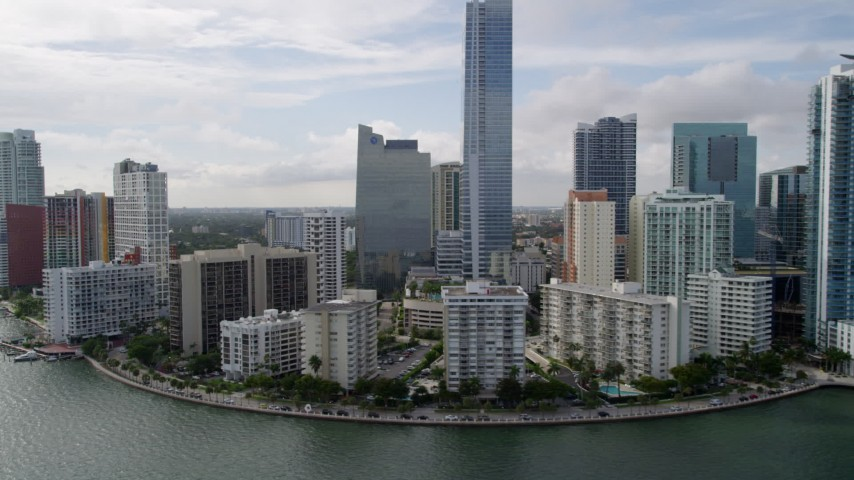 5K stock footage aerial video of waterfront condos by the Four Seasons Hotel in Downtown Miami, Florida Aerial Stock Footage | AX0021_125