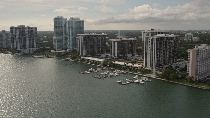 5K stock footage aerial video flyby waterfront condo complexes on the shore of Biscayne Bay in Downtown Miami, Florida Aerial Stock Footage | AX0021_126