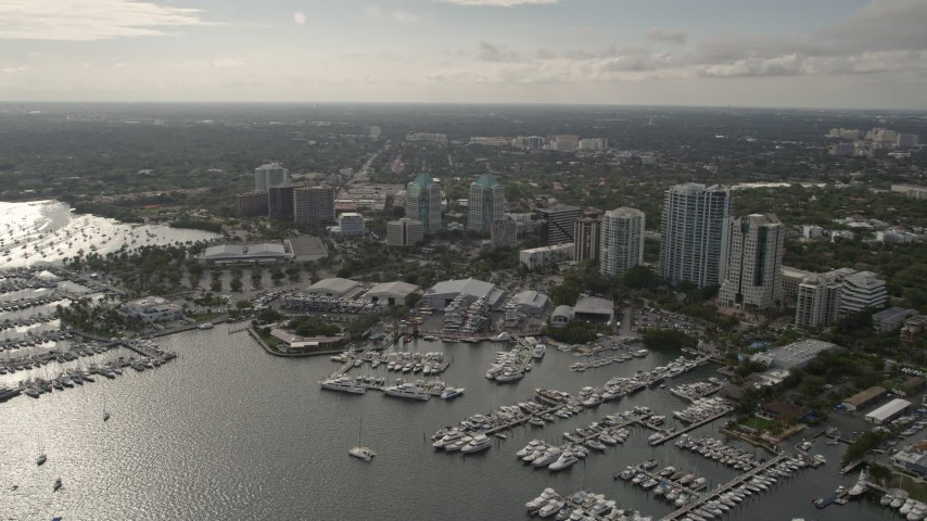5K stock footage aerial video flyby Dinner Key Marina in Coconut Grove, Florida Aerial Stock Footage | AX0021_149
