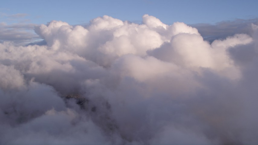5K stock footage aerial video fly over thick bank of clouds over Miami at sunset, Florida Aerial Stock Footage | AX0022_005