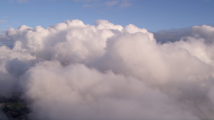 5K stock footage aerial video approach thick cloud formation over Miami at sunset, Florida Aerial Stock Footage | AX0022_008