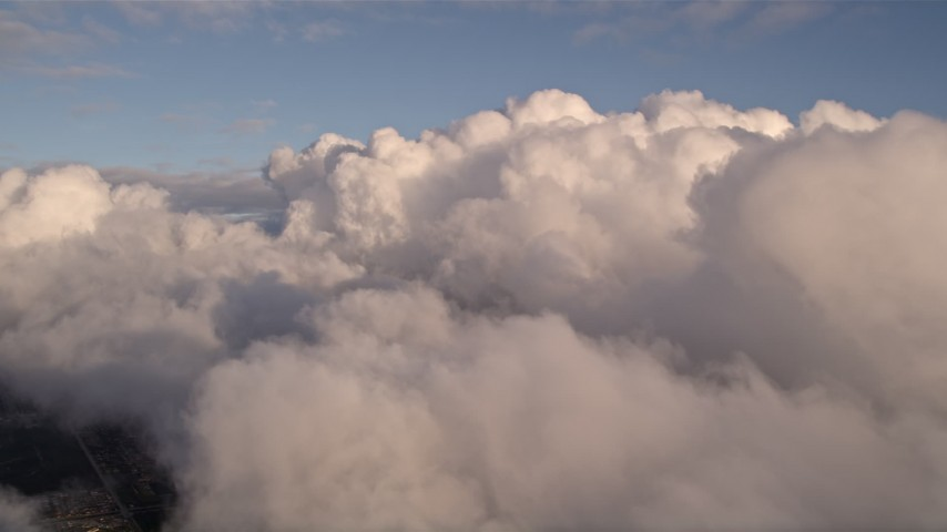5K stock footage aerial video approach thick cloud formation over Miami at sunset, Florida Aerial Stock Footage | AX0022_008E