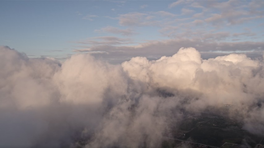 5K stock footage aerial video pan across formation of clouds at sunset over Miami, Florida Aerial Stock Footage | AX0022_010