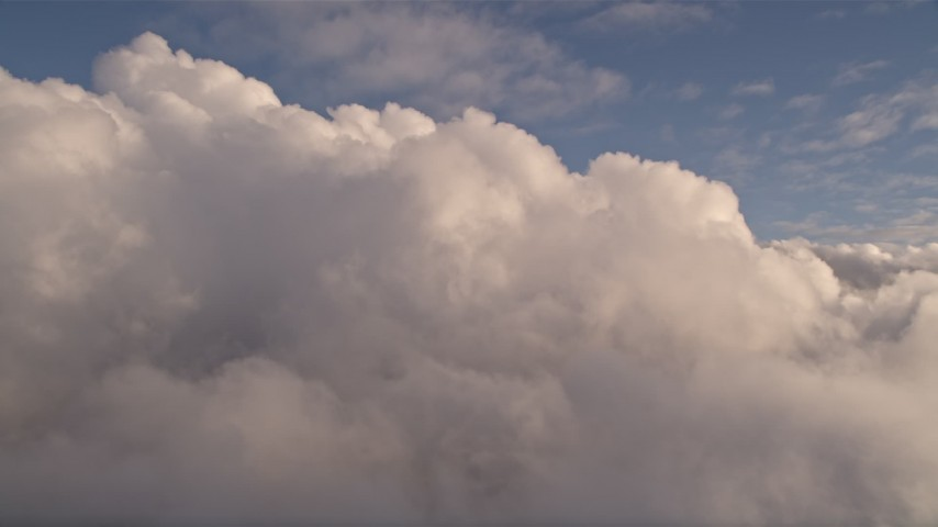 5K stock footage aerial video of passing cloud formation at sunset over Miami, Florida Aerial Stock Footage   AX0022_012