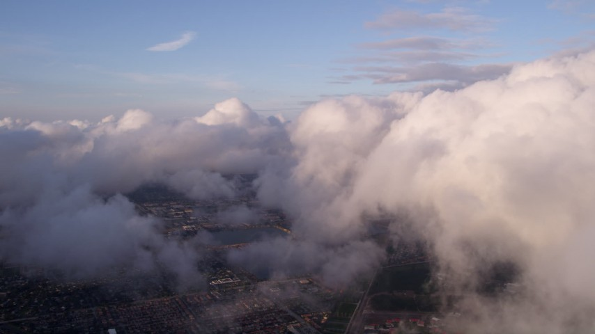 5K stock footage aerial video pan across cloud formation at sunset over Miami, Florida Aerial Stock Footage | AX0022_013