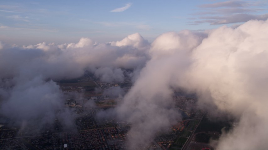 5K stock footage aerial video of approaching thick cover of clouds at sunset over Miami, Florida Aerial Stock Footage | AX0022_014