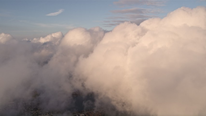 5K stock footage aerial video approach cloud formation over Miami at sunset, Florida Aerial Stock Footage   AX0022_015