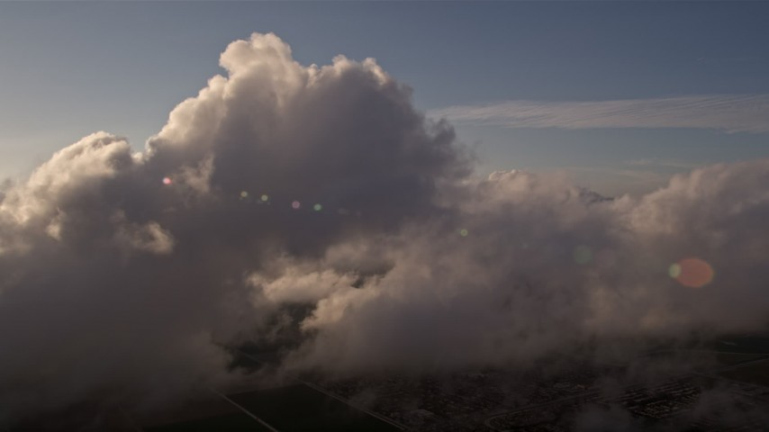 5K stock footage aerial video flyby a cloud formation at sunset over Miami, Florida Aerial Stock Footage | AX0022_017