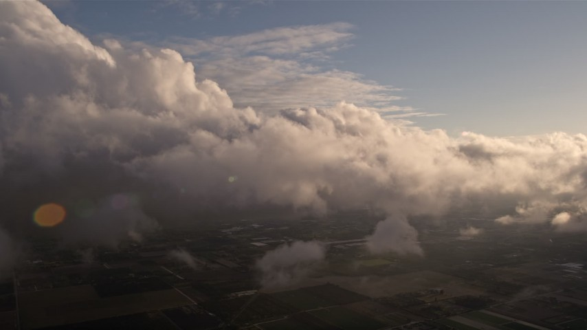 5K stock footage aerial video approach the side of a cloud formation at sunset over Miami, Florida Aerial Stock Footage | AX0022_018