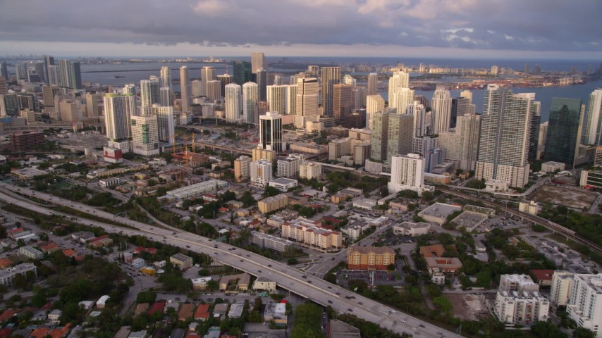 5K stock footage aerial video approach Downtown Miami skyscrapers at sunset from suburbs, Florida Aerial Stock Footage | AX0022_027