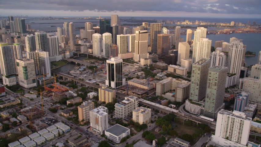 5K stock footage aerial video approach skyscrapers in Downtown Miami at sunset, Florida Aerial Stock Footage | AX0022_028