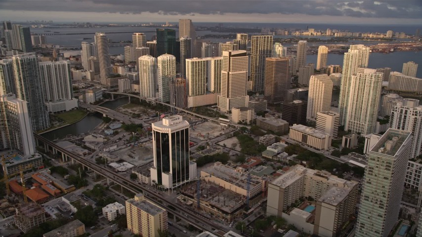 5K stock footage aerial video approach skyscrapers in Downtown Miami at sunset, Florida Aerial Stock Footage   AX0022_028E