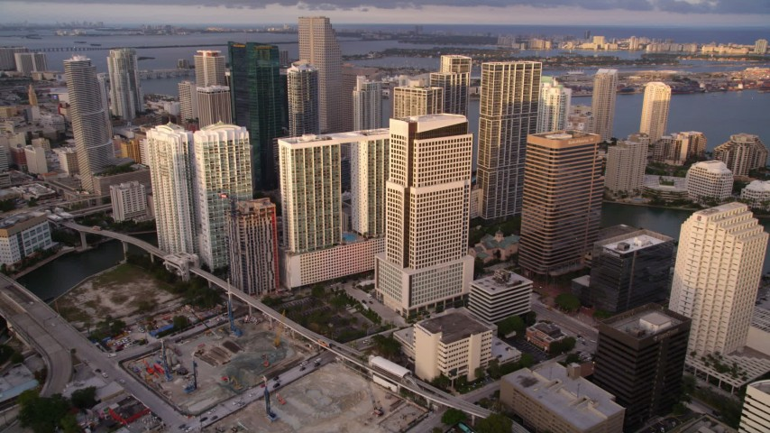 5K stock footage aerial video of approaching modern high-rises in Downtown Miami at sunset, Florida Aerial Stock Footage | AX0022_029