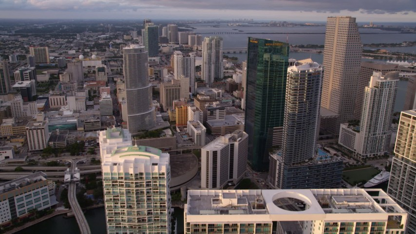 5K aerial video fly over modern high-rise to approach Epic Hotel and Wells Fargo Center in Downtown Miami at sunset, Florida Aerial Stock Footage   AX0022_030