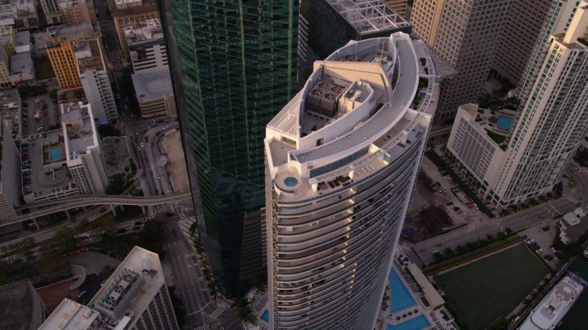 5K stock footage aerial video approach Epic Hotel and tilt to bird's eye view in Downtown Miami at sunset, Florida Aerial Stock Footage | AX0022_031