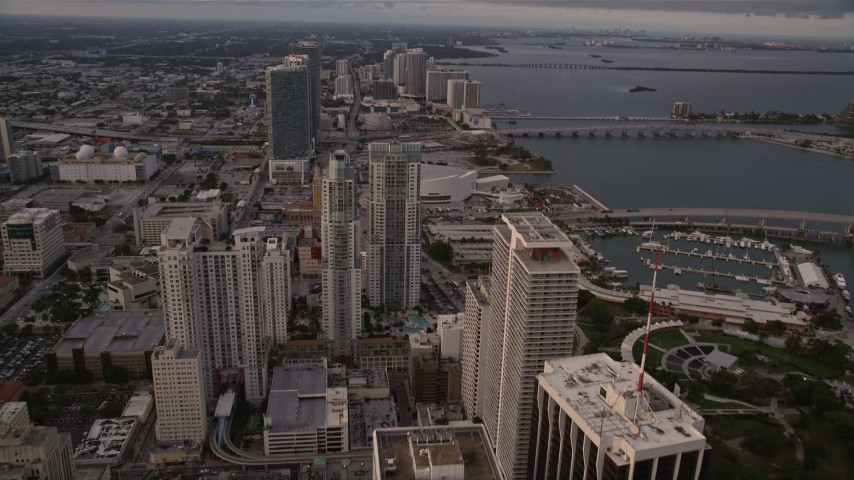 5K stock footage aerial video tilt to reveal and approach skyscrapers in Downtown Miami at sunset, Florida Aerial Stock Footage | AX0022_032
