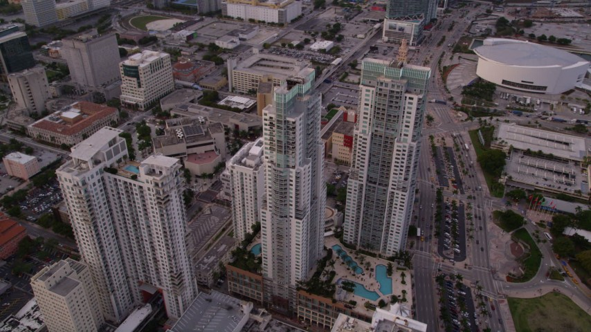 5K stock footage aerial video approach Vizcayne towers in Downtown Miami at sunset, Florida Aerial Stock Footage | AX0022_033