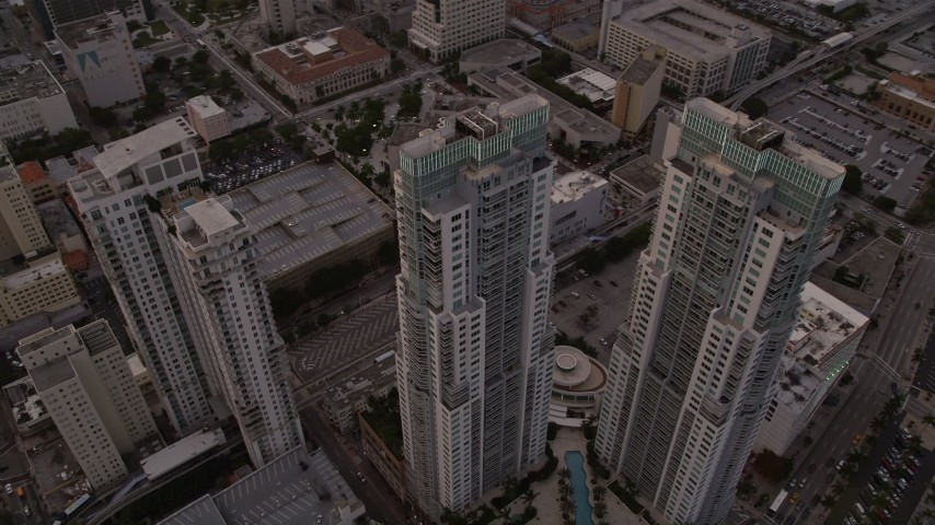 5K stock footage aerial video of the Vizcayne towers in Downtown Miami at sunset, Florida Aerial Stock Footage   AX0022_033E