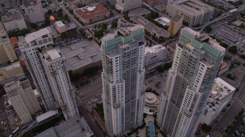 5K stock footage aerial video orbit modern towers of Vizcayne in Downtown Miami at sunset, Florida Aerial Stock Footage | AX0022_034