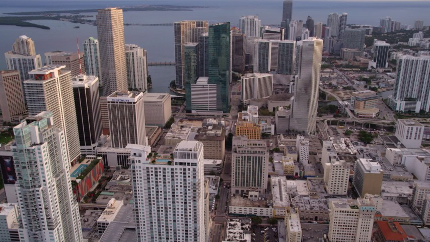 5K stock footage aerial video approach skyscrapers on the bay shore in Downtown Miami at sunset, Florida Aerial Stock Footage | AX0022_035