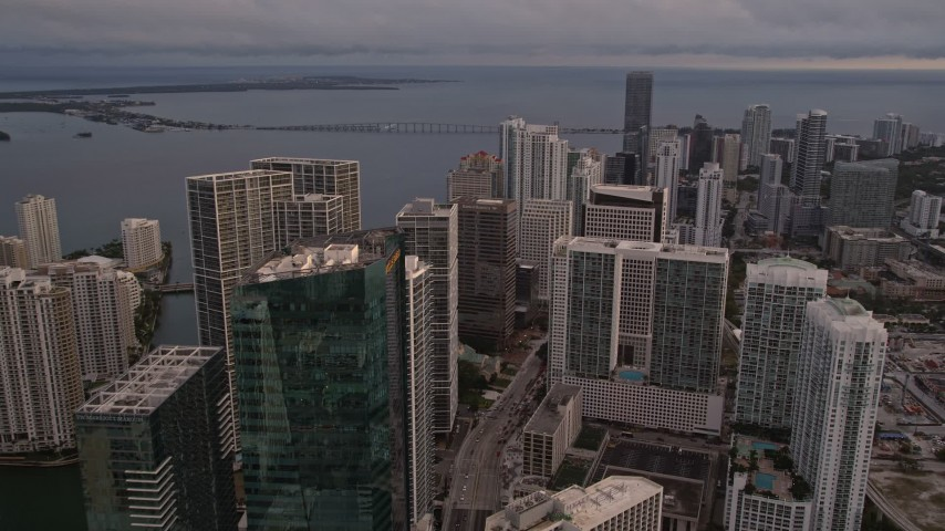 5K stock footage aerial video approach skyscrapers on the bay shore in Downtown Miami at sunset, Florida Aerial Stock Footage | AX0022_035E