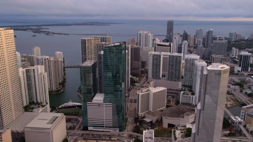5K stock footage aerial video approach 500 Brickell and bayside skyscrapers in Downtown Miami at sunset, Florida Aerial Stock Footage   AX0022_037