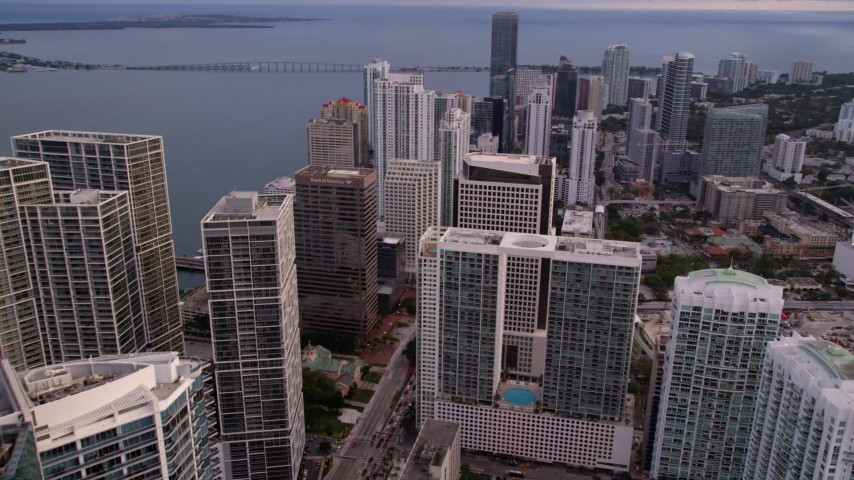 5K stock footage aerial video approach 500 Brickell in Downtown Miami at sunset in Florida Aerial Stock Footage | AX0022_038