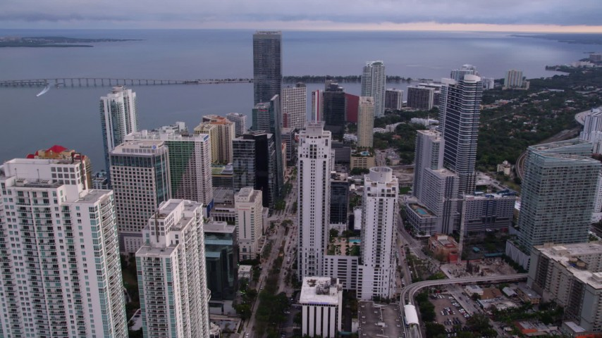 5K stock footage aerial video fly over Downtown Miami skyscrapers to approach Four Seasons Hotel at sunset, Florida Aerial Stock Footage | AX0022_040