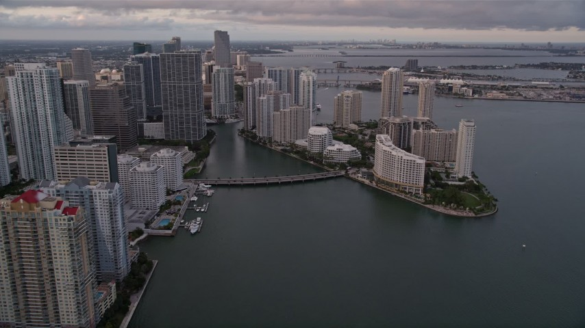 5K stock footage aerial video approach the bridge linking Downtown Miami with Brickell Key at sunset, Florida Aerial Stock Footage | AX0022_044E