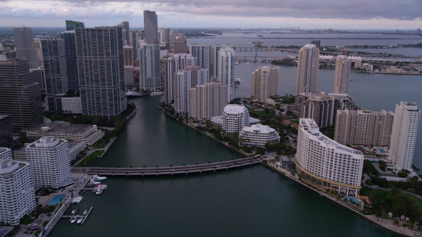 5K stock footage aerial video approach the bridge linking Downtown Miami and Brickell Key at sunset, Florida Aerial Stock Footage | AX0022_045