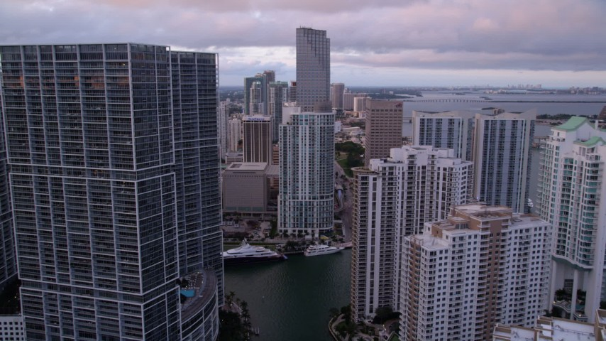 5K stock footage aerial video fly between Brickell Key and Icon Brickell in Downtown Miami at sunset, Florida Aerial Stock Footage | AX0022_046
