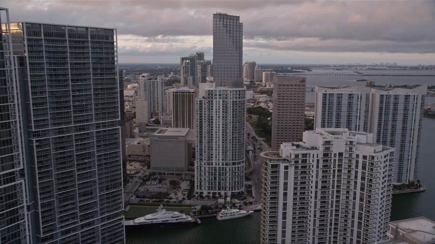 5K stock footage aerial video fly between Brickell Key and Icon Brickell in Downtown Miami at sunset, Florida Aerial Stock Footage | AX0022_046E