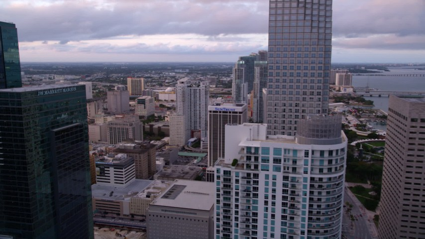 5K stock footage aerial video flyby skyscrapers to approach high-rises in Downtown Miami at sunset, Florida Aerial Stock Footage | AX0022_047