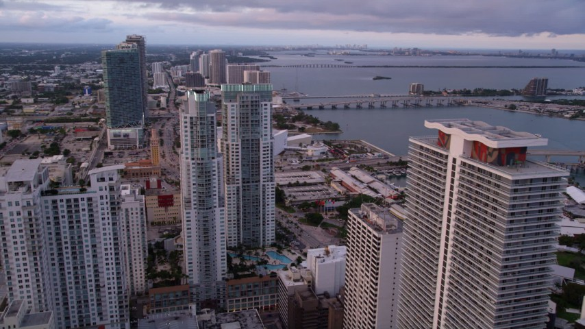 5K stock footage aerial video approach the modern towers of Vizcayne in Downtown Miami at sunset, Florida Aerial Stock Footage | AX0022_048