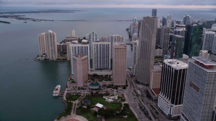 5K stock footage aerial video of waterfront skyscrapers around Bayfront Park in Downtown Miami at sunset, Florida Aerial Stock Footage | AX0022_050