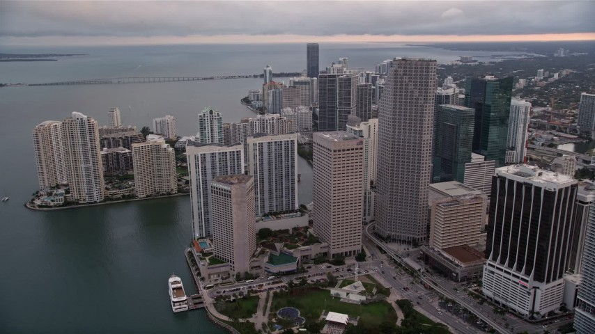 5K stock footage aerial video of waterfront skyscrapers around Bayfront Park in Downtown Miami at sunset, Florida Aerial Stock Footage | AX0022_050E