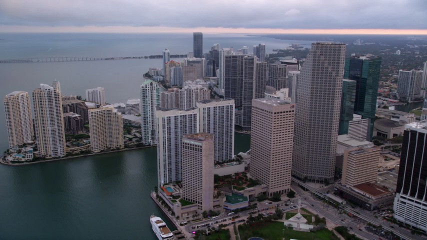 5K stock footage aerial video of skyscrapers on the shore of Biscayne Bay in Downtown Miami at sunset, Florida Aerial Stock Footage | AX0022_051