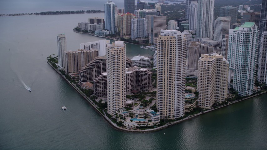 5K stock footage aerial video of waterfront skyscrapers on Brickell Key in Downtown Miami at sunset, Florida Aerial Stock Footage | AX0022_052