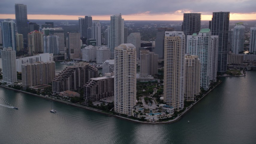 5K stock footage aerial video flyby skyscrapers on Brickell Key and Downtown Miami at sunset, Florida Aerial Stock Footage | AX0022_053