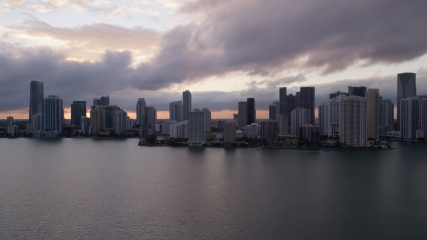 5K stock footage aerial video of Downtown Miami skyline at sunset seen from Biscayne Bay, Florida Aerial Stock Footage | AX0022_054