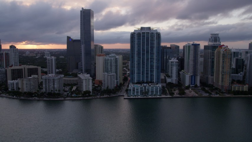 5K stock footage aerial video approach skyscrapers and high-rise hotel in Downtown Miami at sunset, Florida Aerial Stock Footage | AX0022_057