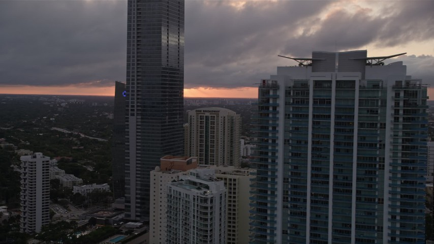 5K stock footage aerial video flyby Four Seasons Hotel and Jade at Brickell Bay in Downtown Miami at sunset, Florida Aerial Stock Footage | AX0022_059