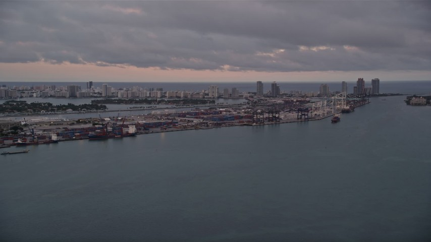 5K stock footage aerial video of Port of Miami seen from Biscayne Bay at sunset in Florida Aerial Stock Footage | AX0022_060
