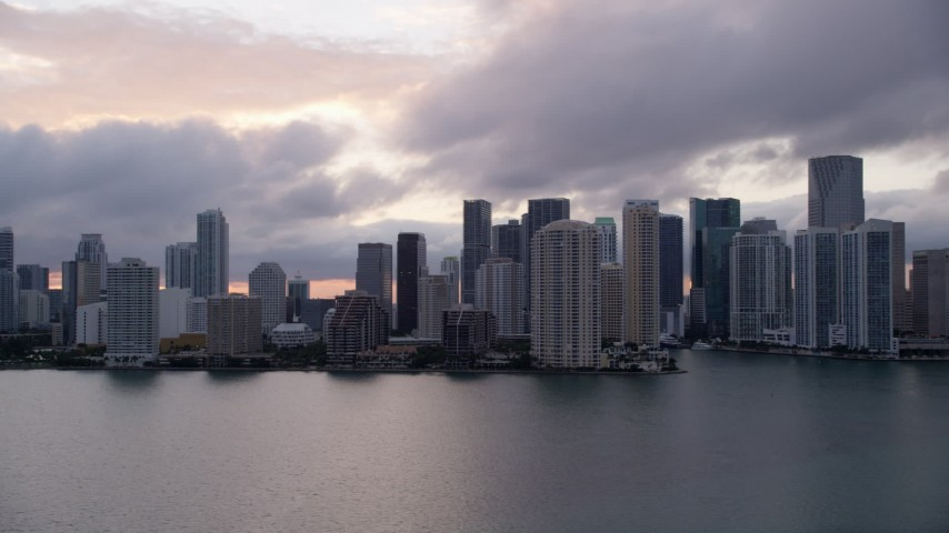 5K stock footage aerial video of Downtown Miami coastal skyline at sunset, Florida Aerial Stock Footage | AX0022_061