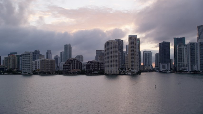 5K stock footage aerial video of the skyline of the coastal city of Downtown Miami at sunset, Florida Aerial Stock Footage | AX0022_062