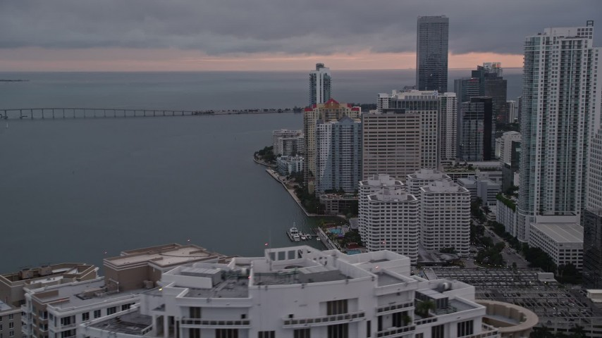 5K stock footage aerial video flyby bayfront skyscrapers to reveal Icon Brickell in Downtown Miami at sunset, Florida Aerial Stock Footage | AX0022_066